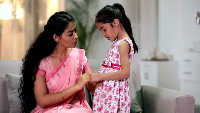 mother checking abdomen pain of her sick daughter, delhi, india - pain stock videos & royalty-free footage