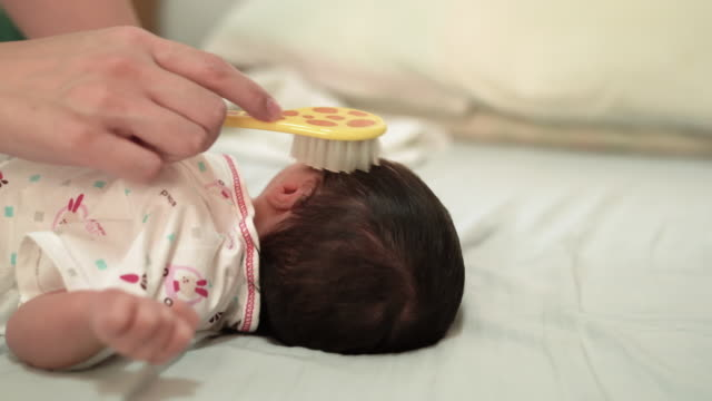 mother comb hair baby - hairbrush stock videos & royalty-free footage