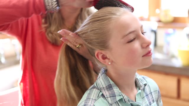 mother combing daughters hair - brushing hair stock videos & royalty-free footage