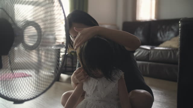 mother combing her daughter's hair - electric fan stock videos & royalty-free footage