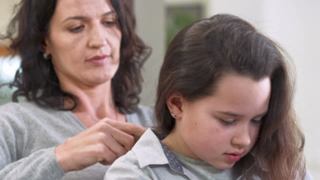 HD: Mother Combing Her Daughter's Hair