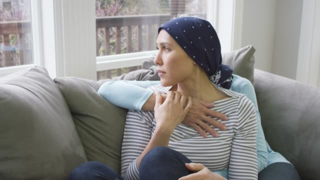 mother comforting her daughter who is recovering from cancer - cancer illness stock videos & royalty-free footage
