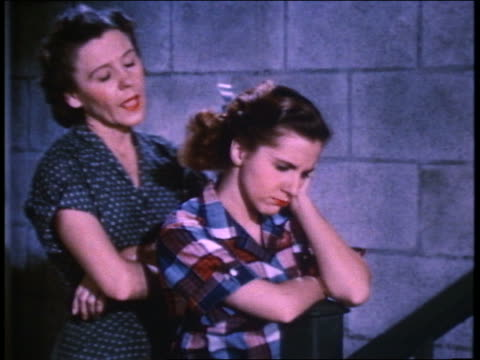 1952 mother comforting young woman at staircase in basements - negative emotion stock videos & royalty-free footage