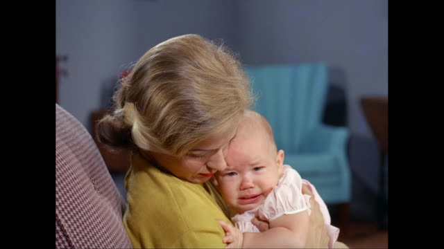 vidéos et rushes de ms mother consoling crying daughter / united states - bébés filles