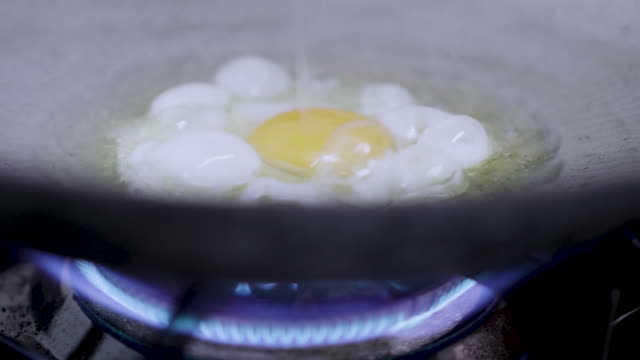 Mother Cooking eggs
