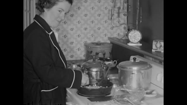 1952 Mother cooks breakfast, Girls receive money as Christmas presents Home Movie