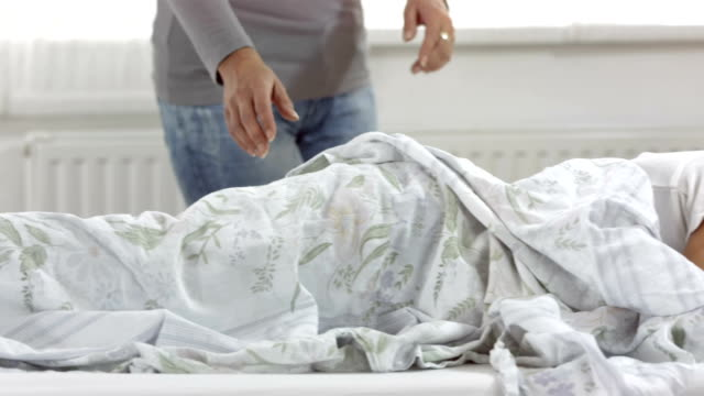 HD DOLLY: Mother Covering Her Sick Son With Blanket