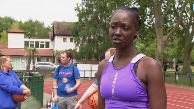 mother creates basketball club to help children with learning disabilities access the sport; england: london: ext gv grace colverd spinning... - shooting baskets stock videos & royalty-free footage