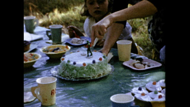 mother cuts cake at boy's birthday party. - childhood stock videos & royalty-free footage