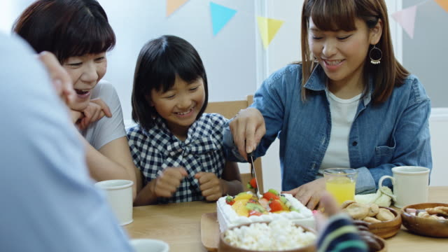 Mother Cutting Birthday Cake