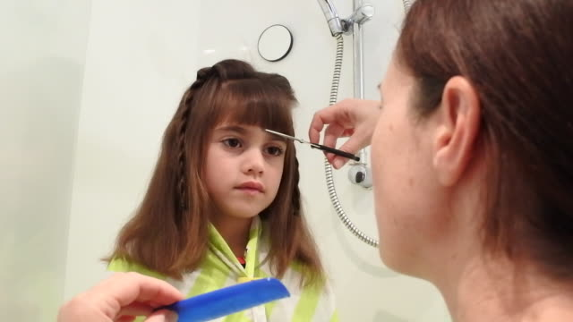 mother cutting child girl hair - bangs stock videos and b-roll footage