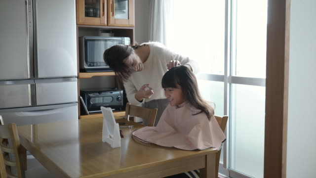 mother cutting her daughter's hair - bangs stock videos & royalty-free footage