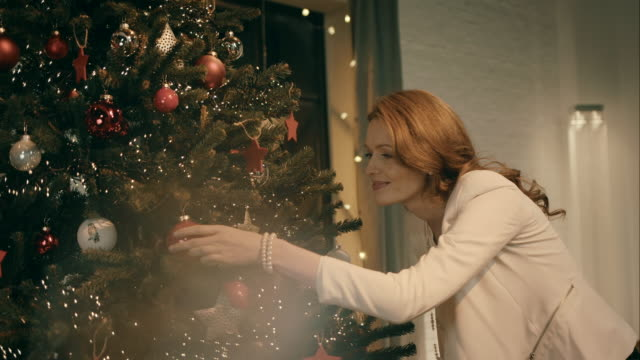 Mother decorating christmas tree