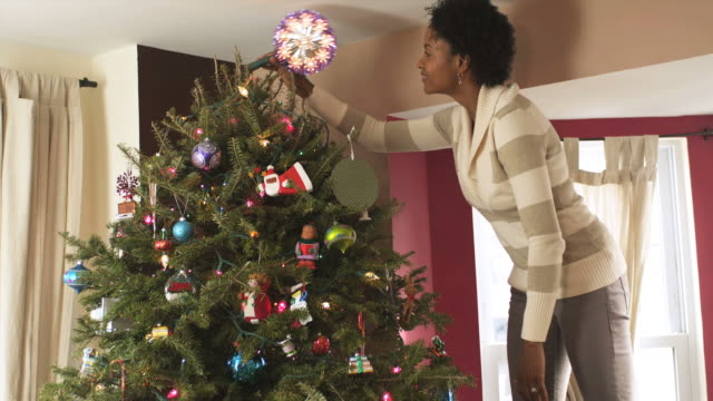 ms tu mother decorating xmas tree / newark, new jersey, usa - ladder stock videos and b-roll footage