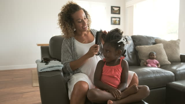 A Mother Doing Daughter's Hair