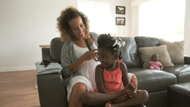a mother doing daughter's hair - single mother stock videos & royalty-free footage