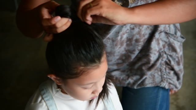 a mother doing daughter's hair - brushing hair stock videos & royalty-free footage