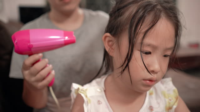 mother drying hair of her daughter - hairbrush stock videos & royalty-free footage