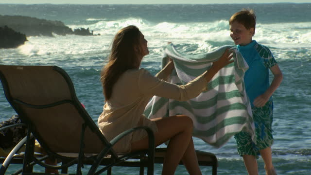 mother drying son with beach towel outdoors - see other clips from this shoot 1141 stock videos & royalty-free footage
