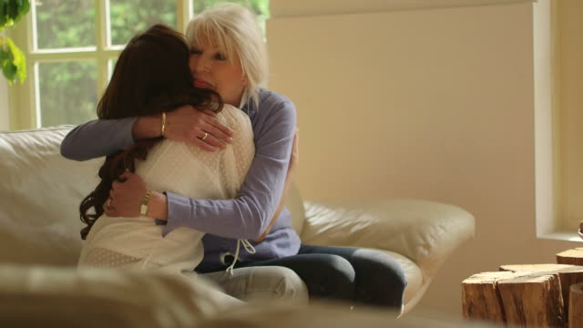 mother embracing daughter - daughter stock videos & royalty-free footage