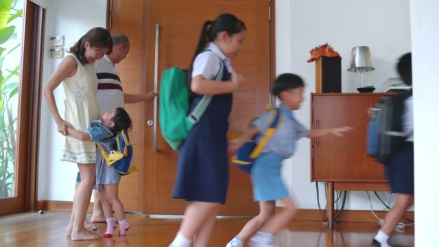 mother embracing her children when coming home - school uniform stock videos & royalty-free footage