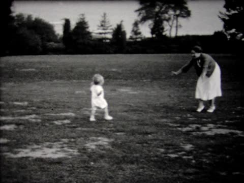 1932 mother encouraging reluctant baby to walk - 1932 stock videos & royalty-free footage