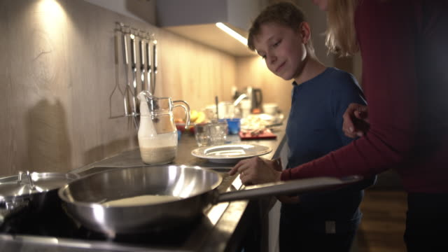 mother explaining stove to her son - real people stock videos & royalty-free footage