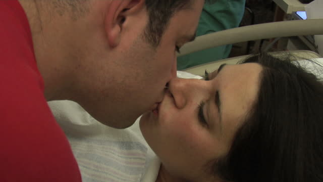 mother, father, and newborn - childbirth stock videos and b-roll footage