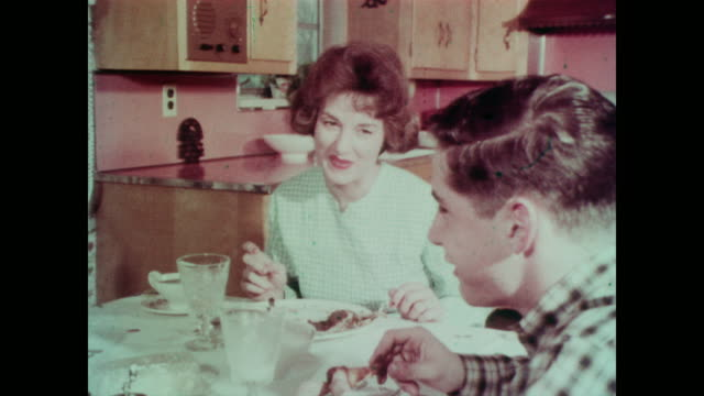 1967 Mother, father and two sons eat dinner while voiceover discusses food preservation