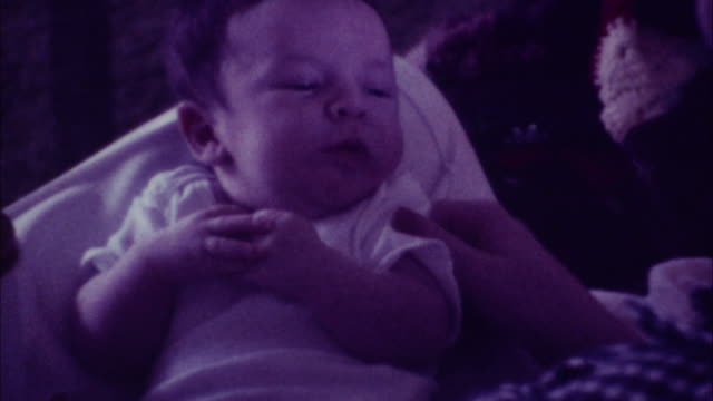 mother feeding baby - 70's 8mm film - home movie stock videos & royalty-free footage