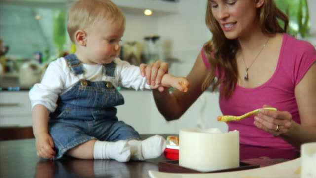slo mo ms mother feeding baby boy (6-11 months) / london, united kingdom - see other clips from this shoot 1518 stock videos & royalty-free footage