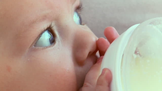 cu tu mother feeding baby boy (2-5 months) milk from bottle / vrhnika, slovenia - vrhnika stock videos & royalty-free footage