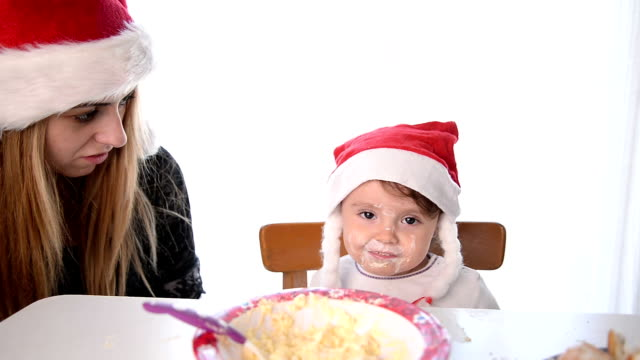 mother feeding baby with spoon - santa hat stock videos and b-roll footage