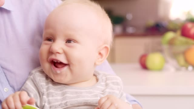 mother feeding happy baby with a spoon - spoon stock videos & royalty-free footage