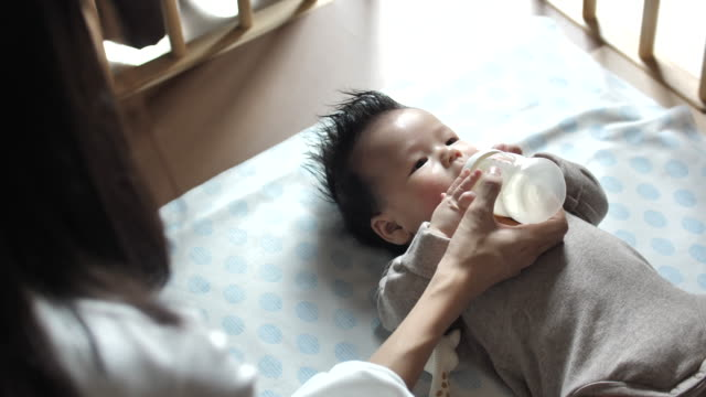 mother feeding her baby - social services stock videos & royalty-free footage