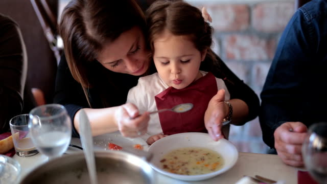 mother feeding her child - chowder stock videos and b-roll footage