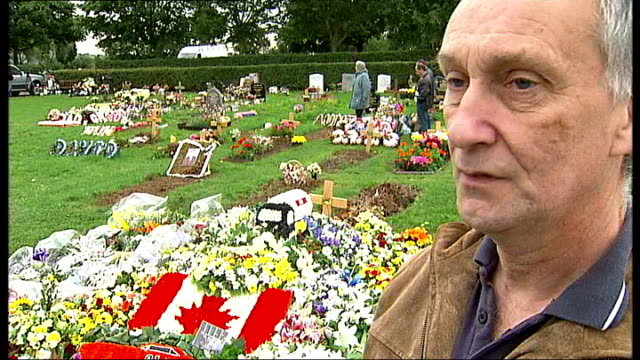 mother fights against basildon council's plan to cut her daughter's grave in half; david foley standing with two family members at grave david foley... - lily family stock videos & royalty-free footage