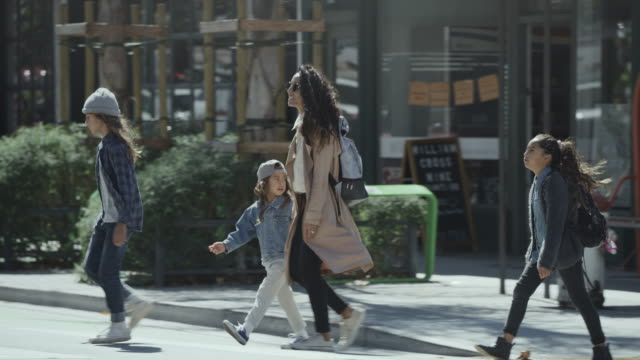 mother gesturing to children while crossing street in city / san francisco, california, united states - pavement stock videos & royalty-free footage