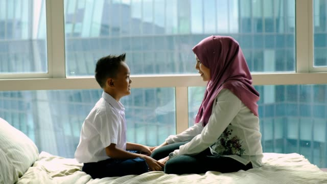 mother gets her son ready for school - malay family stock videos and b-roll footage