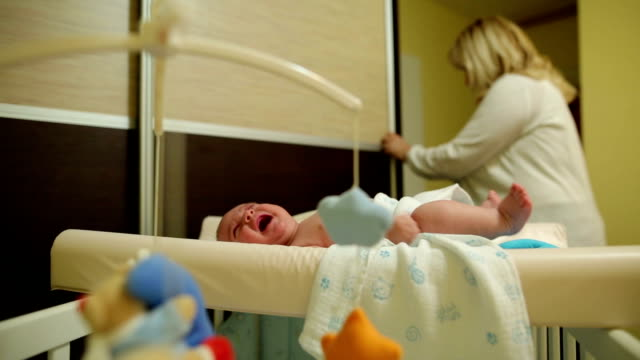 mother getting dressed her baby - changing nappy stock videos & royalty-free footage