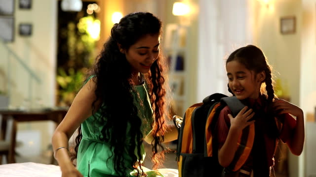 mother getting her daughter ready for school, delhi, india - preparation stock videos & royalty-free footage