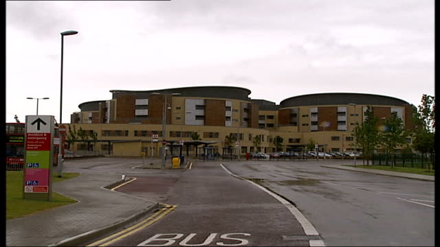 mother gives birth to premature baby in hospital toilet romford ext general views queen's hospital - 生後1ヶ月点の映像素材/bロール