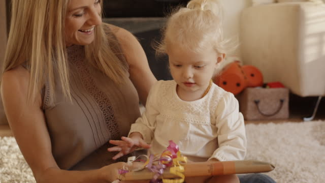 mother giving daughter present indoors - birthday gift stock videos & royalty-free footage
