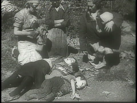 a mother grieves for her dead children in a war-torn village; adolf hitler laughs with war strategists. - martyr stock videos & royalty-free footage