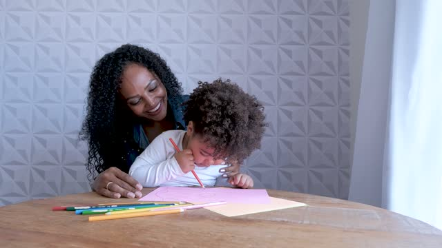 mother having fun with daughter during play drawing on colored sheets. - 35 39 years stock videos & royalty-free footage