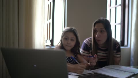 mother helping daughter studying using laptop at home - encouragement stock videos & royalty-free footage