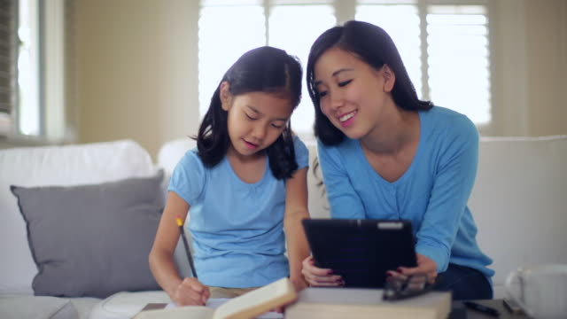 ms mother helping daughter with her homework. - homework stock videos & royalty-free footage