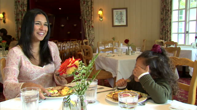 ms mother helping daughter (6-7) with meal at table / heber city, utah, usa - dining table stock videos & royalty-free footage