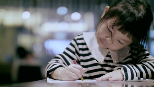 mother helping happy daughter with homework - 4 5 years stock videos & royalty-free footage