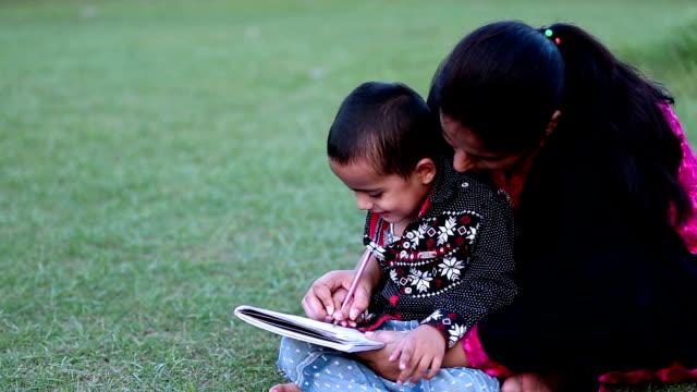 Mother helping her son in doing school homework